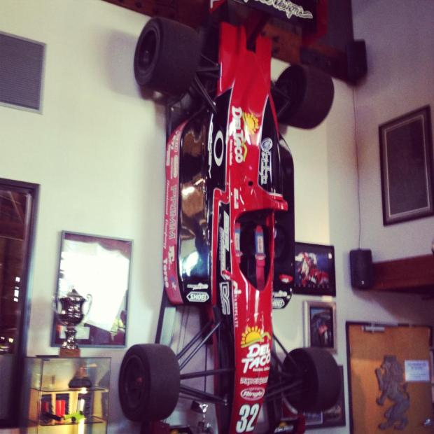 Everyone should have a race car as wall art in their office...totally normal...