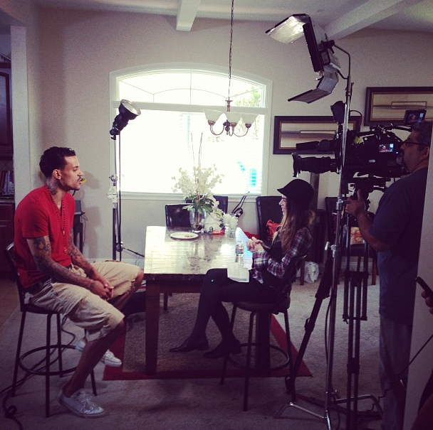 Matt Barnes being interview at his home Tuesday by Farrell of E! News.